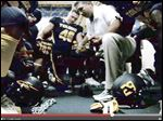 This frame grab of a University of Toledo video on YouTube  shows coach Matt Campbell leading the Rockets football team in prayer before a 2012 game.