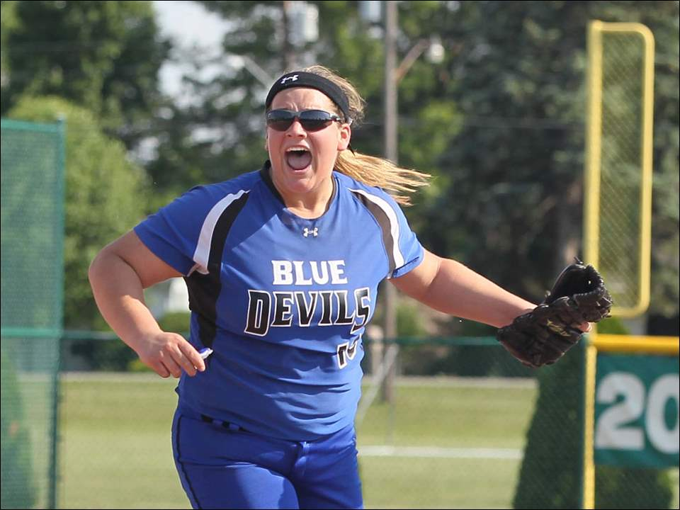 Springfield pitcher Lexi Buck (19) celebrates the win.