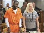 Jermaine Smith, with attorney Jane Roman, is sentenced Friday in Lucas County Common Pleas Court.