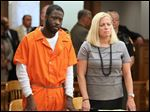 Jermaine Smith, with attorney Jane Roman, is sentenced in Lucas County Common Pleas Court.
