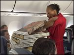 Tweet from Riley Vasquez  @RileyVasquez  from the Delta piza party where Marco's pizza was bought fro passengers after the plane was delayed.   TWITTER PHOTO @RileyVasquez    NOT BLADE