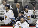 Toledo Walleye head coach Derek Lalonde gives instruction to his players against the Fort Wayne Komets during an ECHL playoff game at the Huntington Center on May 2.