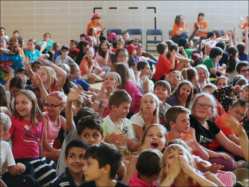 Kindergarden through fifth grade students clap and cheer in appreciation of their teachers during the last day of school Wednesday at Stranahan Elementary School.