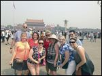 Participants in the Lourdes University MBA program pause for a tourist day outside Beijing's Forbidden City. From left: Ryan Butt, Patricia O'Connell, Nicole Menden, Mary Kolasinski (glasses/flowered shirt), Eileen Muery, Rosemary Tappan (hat), Eyvonne Frye, Richard Hochkins, and Maribeth Rabara. Mr. Butt and Ms. O'Connell are Lourdes professors. Ms. Menden, Ms. Kolasinski, Ms. Frye, Mr. Hochkins, and Ms. Rabara are MBA candidates. Ms. Muery and Ms. Tappan are travelers who participated in the MBA immersion to China.