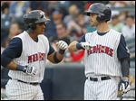 Mud Hens' third baseman Jefry Marte, left, celebrates his home run in the bottom of the second inning with left fielder Jeff McVaney on Friday.