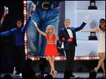 Alan Cumming, Kristin Chenoweth and dancers perform a tribute to Tommy Tune, winner of the lifetime achievement award at the 69th annual Tony Awards at Radio City Music Hall.
