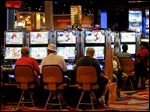 Gamblers work the slot machines at Hollywood Casino Toledo