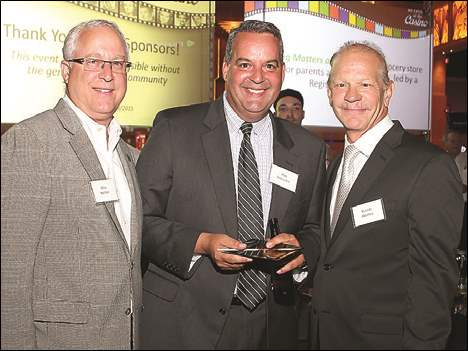 From left are ProMedica bigwigs Alan Sattler, Jim Wheeler, and Randy Oostra at ProMedica's Casino Night.