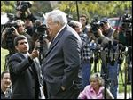 Then-House Speaker, Dennis Hastert walks away from the media after answering questions about ex-Rep. Mark Foley's involvement with former pages at a news conference in Aurora, Ill. The 73-year-old former Speaker is scheduled to make his first court appearance Federal Court on Tuesday in Chicago. A May 28 indictment said he agreed to pay $3.5 million to someone from his days as high school teacher and wrestling coach not to reveal a secret about past misconduct. He's charged with violating banking laws and lying to the FBI, with each of those two counts carrying a maximum five-year prison term.