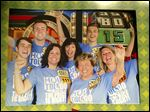 Jamey Burson, left, cheers with friends and family on the set of 'The Price Is Right.'