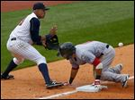 Mud Hens third baseman Jefry Marte gets the throw late allowing Syracuse's Darin Mastroianni to be safe during a game at Fifth Third Field earlier this month.