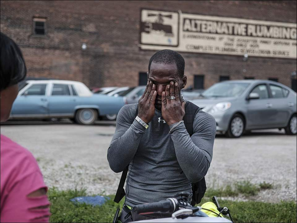 Charles Veley, 41, wipes away tears as he speaks with his mother Ethel Edwards, left, before setting off on his bicycle, Thursday, June 11,  2015.