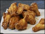 Customers at Pizza Hut's 26 Toledo area locations are testing eight new sauces and rubs for WingStreet chicken wings.