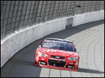 Kurt Busch rounds Turn 1 at Michigan International Speedway. He led the last six laps of a rain-shortened race.