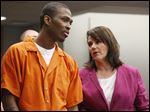 Christopher Nelson, 27, confers with his attorney, Meira Zucker, during his sentencing. He received a life sentence.