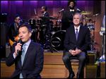 Fallon, left, speaks and former Gov. Bush, right, the new Republican presidential candidate, appears during 'Slow Jam the News.' The show's recurring skit job requires the former Florida governor to recite lines while Fallon, stylized as a 1970s soul man, offers a double entendre.