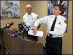 Acting Toledo Fire Chief Karen Marquardt, with Deputy Police Chief Jim O'Bryant, talks about an alleged attack of two Toledo firefighters during a news conference today.