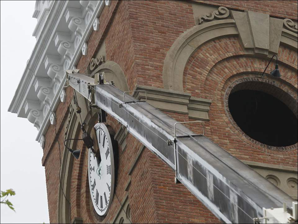 The first of four renovated clock dials is installed inside the Fulton County Courthouse clock tower.