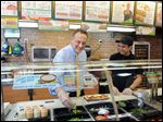 Fred DeLuca, left, Subway's chief executive who as teen began the shop with a friend, faces challenges ahead.