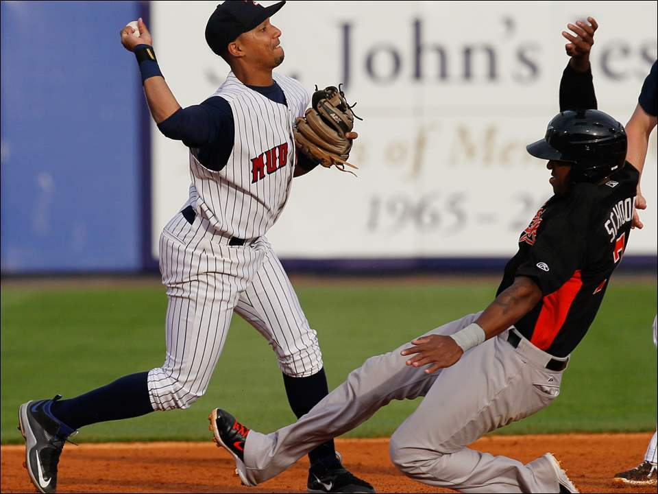 Toledo Mud Hens SS Dixon Machado turns a double play.