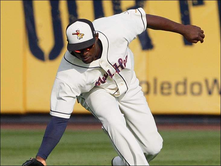 Toledo's center fielder Xavier Avery scoops up a long grounder during the top of the third inning Sunday against Norfolk.