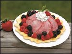 Fruit dessert with berries and whipped cream.