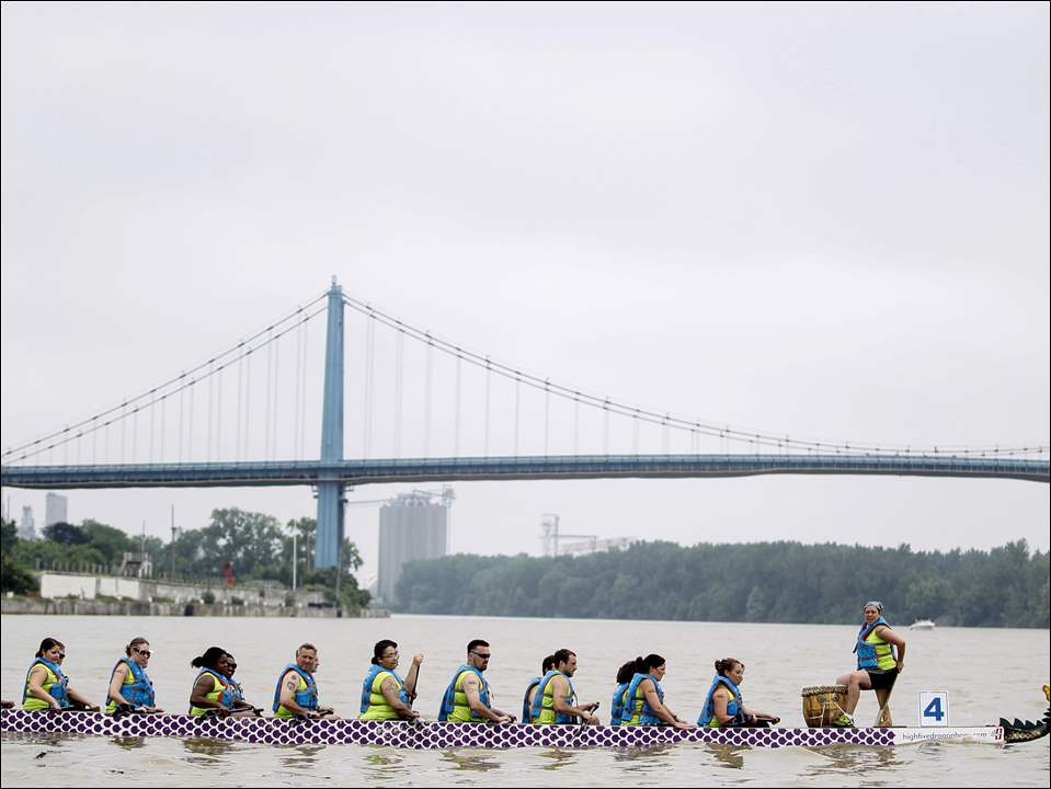 The Toledo Public School team goes to their lane for the start of a race during the Dragon Boat Festival on June 20, 2015, at International Park in Toledo, Ohio.