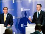 U.S. Secretary of Defense Ashton Carter, left, and Estonian Defense Minister Sven Mikser attend a joint news conference after a meeting in Tallinn, Estonia, today.