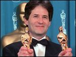 Composer James Horner displays Oscars he won for Original Song and Original Dramatic Score for