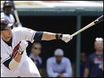Cleveland catcher Yan Gomes hits a two-run single off Detroit reliever Al Alburquerque in the seventh inning.