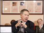 Ohio Governor John Kasich commented on the passage of the state budget by the legislature on Friday at the Ohio Statehouse in Columbus.