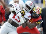 Maryland's Sean Davis brings down Ohio State's Ezekiel Elliott. Maryland is an Under Armour school, Ohio State is Nike.