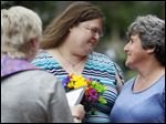 Sandra, left, and Debbie De Steno, exchange vows during a marriage ceremony on Friday at Wood County Courthouse in Bowling Green, Ohio. The Supreme Court ruled earlier today gay marriage legal.