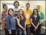 Tonya Colbert, the Upward Bound director at Lourdes, joins Amber Crigger, and Rebekah Wright, front row from left, and Dominique Bryan, Deon Williams, Federico Garza, and adviser Lisa Hess, back row from left.