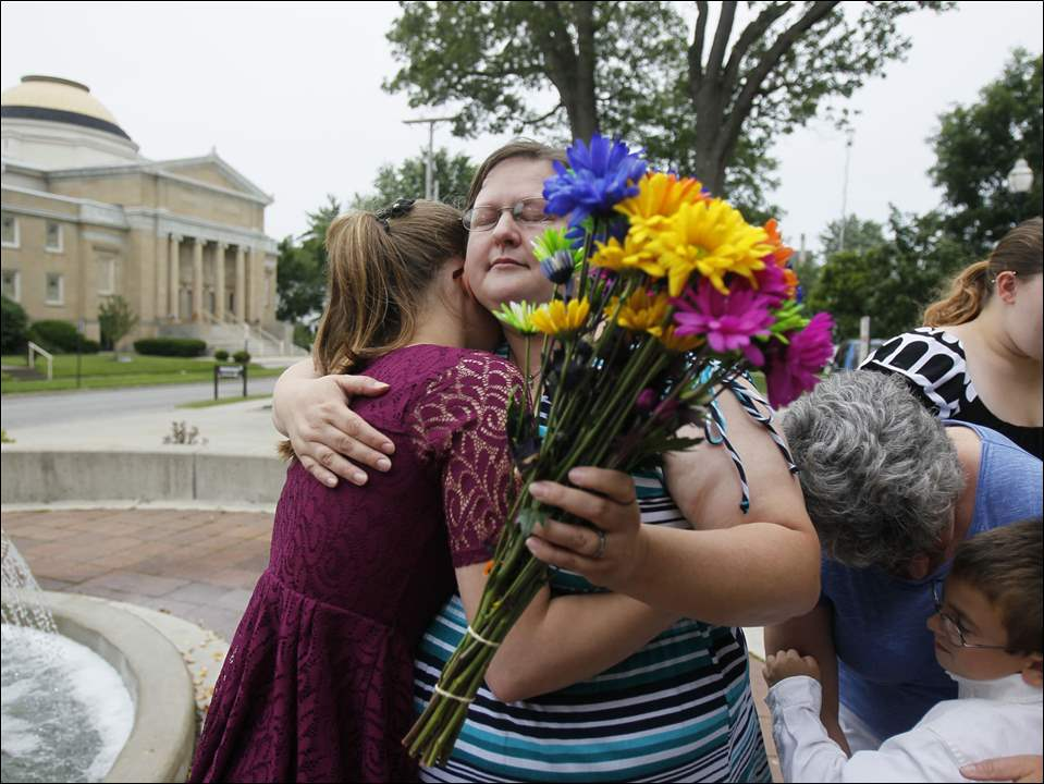 Sandra De Steno hugs her daughter Alyson Baker, 15, after marrying Debbie De Steno on June 26, 2015, at Wood County Courthouse in Bowling Green, Ohio. The Supreme Court ruled earlier today gay marriage legal.