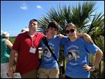 Kellye Voigt, from left, Gabe Voigt, Joe Garvey and Rachel Lindbergh pose for a photo outside the Kennedy Space Center Visitor Complex in Cape Canaveral, Fla., on Sunday.