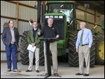 James Zehringer, director of the Ohio Department of Natural Resources, speaks about a phosphorus initiative for Lake Erie at a farm. From left are David Daniels, Ohio director of agriculture, Craig Butler, Ohio EPA director, and Randy Gardner, R., state senator.