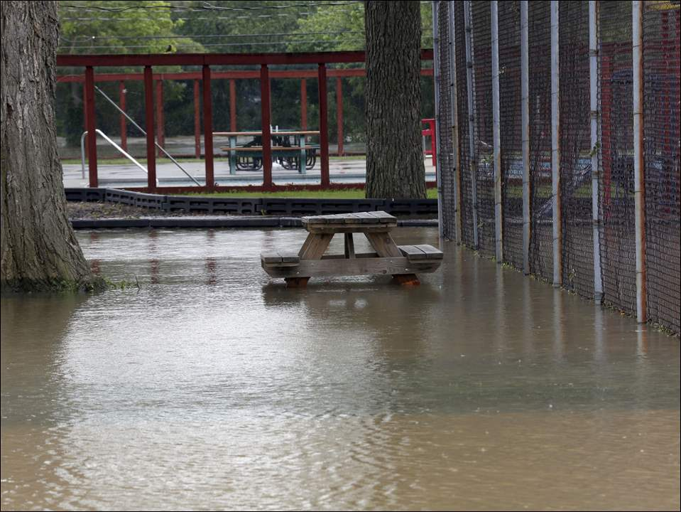 Flood water submerges the ground in Trail Marker Park in Woodville on Tuesday.