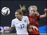 United States' Tobin Heath, left, challenges Germany's Tabea Kemme.