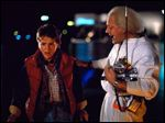 Michael J. Fox, left, as Marty McFly, and Christopher Lloyd as Dr. Emmett Brown, in a scene from the 1985 film,