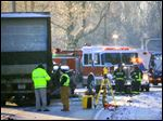 Crews investigate the scene of a double fatal crash involving a 12-ton tactor-trailer loaded with groceries on U.S. 50, near state Route 222, in Stonelick Township, Ohio in January, 2014. At first the crash drew only the attention of Ohio authorities, but 17 months later, federal regulators are questioning whether a defective trailer hitch may be at fault, a hitch that's currently used on about 6,000 semis.