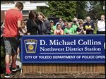 Tammy Dickey, daughter of D. Michael Collins, left, hugs Sandy Drabik Collins, his widow, during the renaming of the northwest district police station to the D. Michael Collins Station on Wednesday.