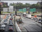 Heavy traffic crawls through the I-75 construction zone near the Collingwood Boulevard overpass. AAA estimates that 41.9 million Americans will travel more than 50 miles from home between Wednesday and Sunday.