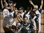 U.S. catcher Lauren Lappin (37) at front, and her teammates of the U.S softball team wave after winning  their game against China at the Women's Softball World Championship in Caracas, Venezuela in June, 2010.