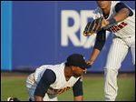 Mud Hens right fielder Steven Moya catches the ball over second baseman Alexi Casilla in the top of the third inning.