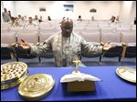 Chaplain Lt. Col. Harold Owens, of the 180th Fighter Wing, leads prayer while kneeling in front of the altar during a contemporary Christian worship service at the 180th Fighter Wing.