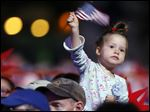 A young girl waves a flag in Boston.