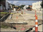 Construction is under way on Second Street near Louisiana Avenue in Perrysburg, where crews are widening the road to add parking. Crews will widen the road one block east and one block west of Louisiana Avenue to add 37 parking spaces.
