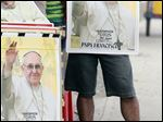 A street vendor sells posters with image of Pope Francis at the entrance of Samanes Park where Pope Francis will give a mass in Guayaquil, Ecuador.