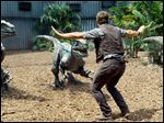 "Chris Pratt is surrounded by raptors in ""Jurassic World""."